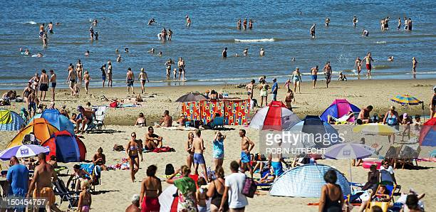People enjoy the sun on a beach on the island of Texel the Netherlands on August 18 where temperatures reached 344 degrees Celsius OUT