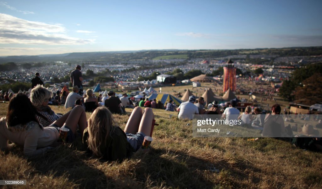 People enjoy the sun weather at the Glastonbury Festival site at Worthy Farm, Pilton on June 24, 2010 in Glastonbury, England. ating its 40th anniversary.