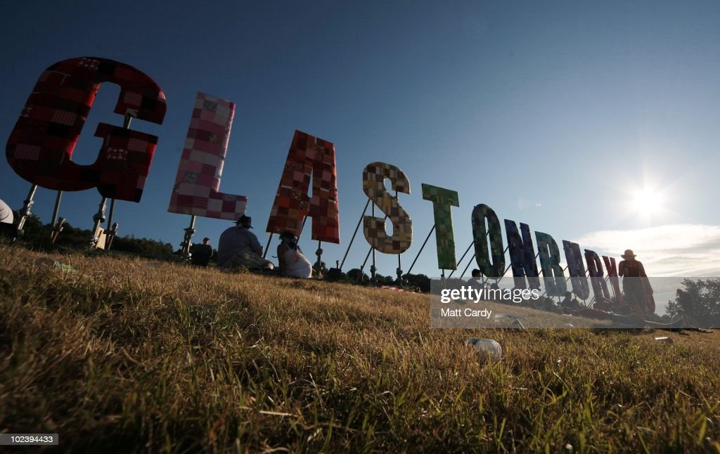 People enjoy the sunny weather at the Glastonbury Festival site at Worthy Farm, Pilton on June 24, 2010 in Glastonbury, England. The gates opened yesterday to what has become Europe's largest music festival and is celebrating its 40th anniversary.