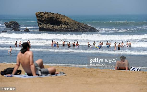 People enjoy the sunny weather on a beach in Biarritz southwestern France on June 4 2015 as temperatures reach 30 degrees in the area AFP PHOTO /...