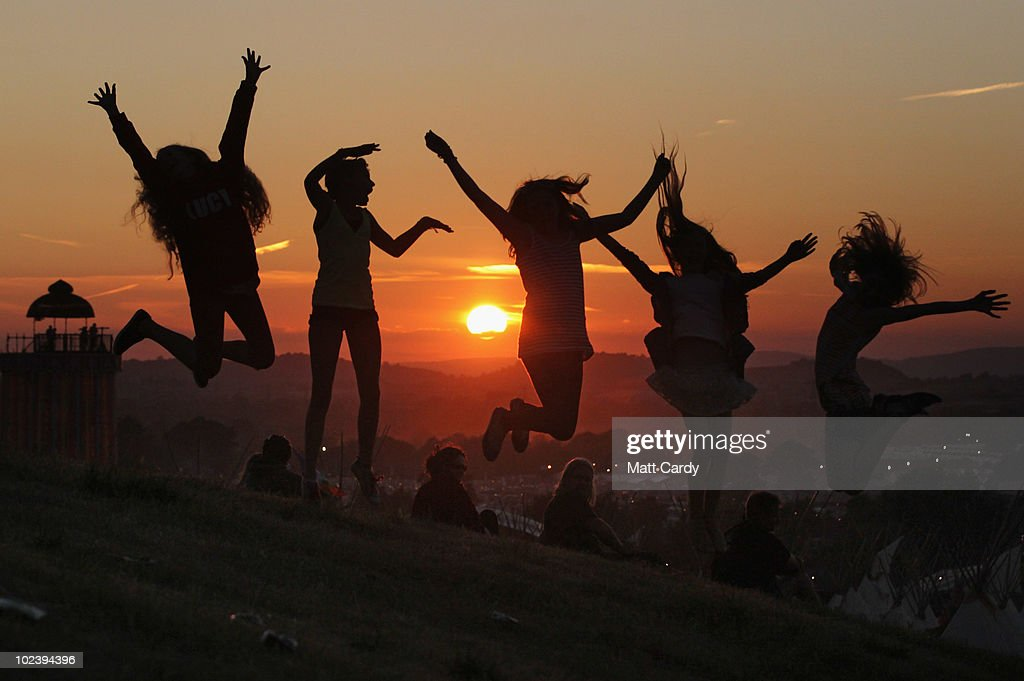 People enjoy the sunset at the Glastonbury Festival site at Worthy Farm, Pilton on June 24, 2010 in Glastonbury, England. The gates opened yesterday to what has become Europe's largest music festival and is celebrating its 40th anniversary.