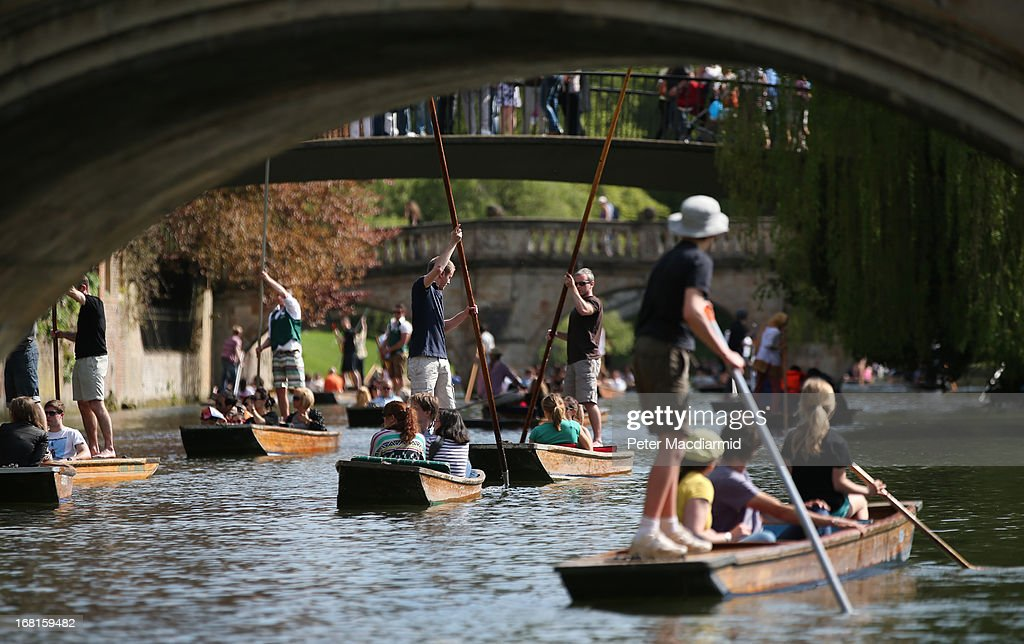 People enjoy the sunshine and punt on the River Cam on May 6, 2013 in Cambridge, England. High temperatures are being experienced by many in southern parts of the United Kingdom during the holiday weekend.
