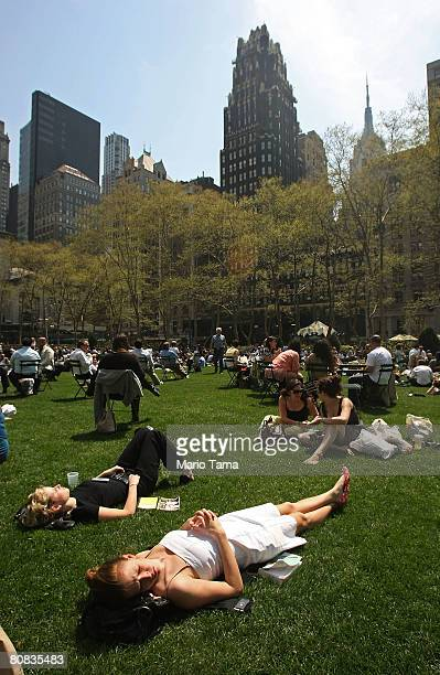 People enjoy the unseasonably warm weather in Bryant Park April 23 2008 in New York City Temperatures reached into the upper 70's today in the city