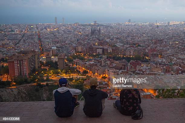 People enjoy the view over the city with 'La Sagrada Familia' in the background on October 26 2015 in Barcelona Spain 'La Sagrada Familia' Foundation...