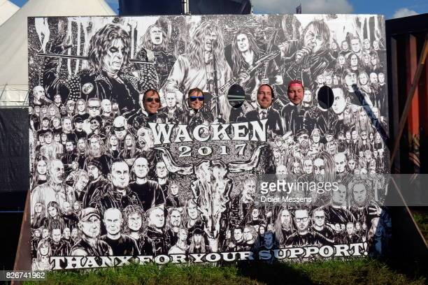 People enjoy the Wacken Open Air festival on August 5 2017 in Wacken Germany Wacken is a village in northern Germany with a population of 1800 that...