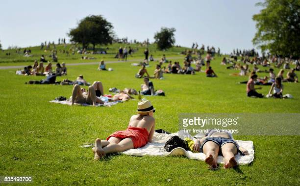 People enjoy the warm weather on London's Primrose Hill