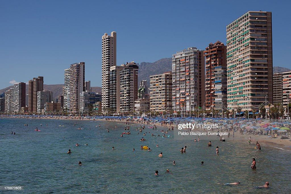 People enjoy the weather on Levante Beach on August 10, 2013 in Benidorm, Spain. Benidorm is one of Europe's top package holiday destinations and one of Spain's busiest tourist destinations. The Costa Blanca hotspot of Benidorm is calculated to have a population of around 72,000, which is estimated to rise to more than 300,000, during the summer months as the tourists and visitors flock to its popular beaches.