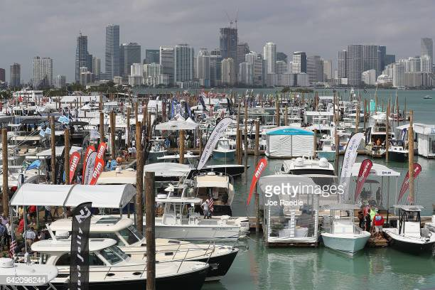 People enjoy themselves as they check out the boats on display at the Progressive Insurance Miami International Boat Show being held at the Miami...