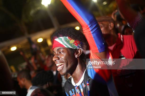 People enjoy themselves at the 'Sounds of Little Haiti' at the Haitian Cultural Complex on May 19 2017 in Miami Florida The artists playing in the...
