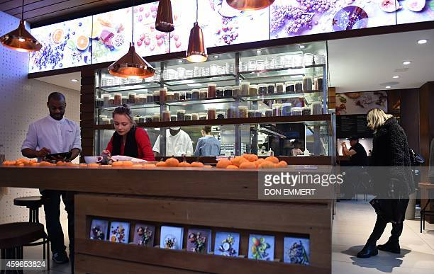 People enjoy themselves inside Chobani SoHo cafe on November 17 2014 in New York Chobani has become the bestselling yogurt in the US netting more...
