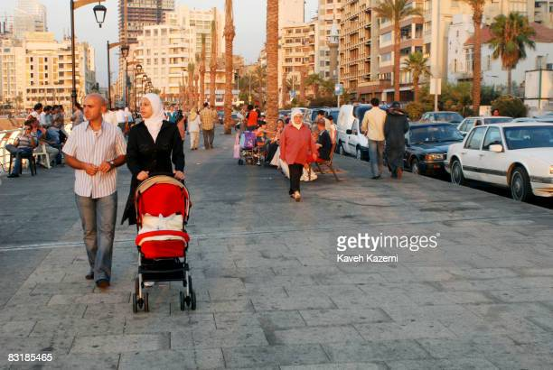 People enjoy themselves walking and standing around by the seaside early Sunday evening in Corniche area of Beirut on August 10 2008 After the...