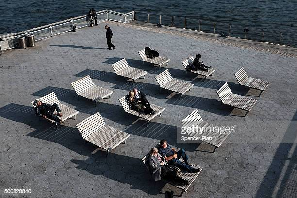 People enjoy unseasonably warm weather in lower Manhattan on December 10 2015 in New York City With Christmas just weeks away temperatures are...
