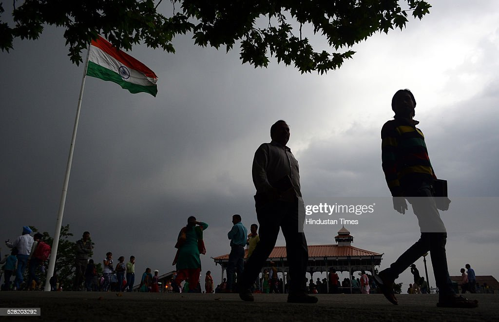 People enjoy walking in the pleasant cool weather at Ridge on May 4, 2016 in Shimla, India.