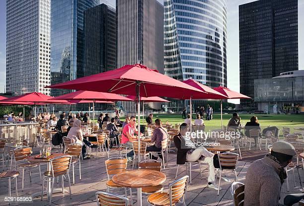 People enjoying a sunny day at La Defense, Paris
