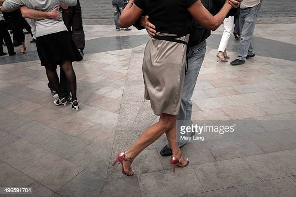 People enjoying a tango dance by the Seine river in summertime Paris France