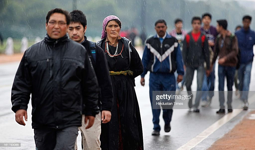 People enjoying as it rains with overcast sky near India Gate , on February 16, 2013 in New Delhi, India. The National capital witnessed a total of 18.6 mm of rains since yesterday and the weather is likely to remain cloudy for another day.