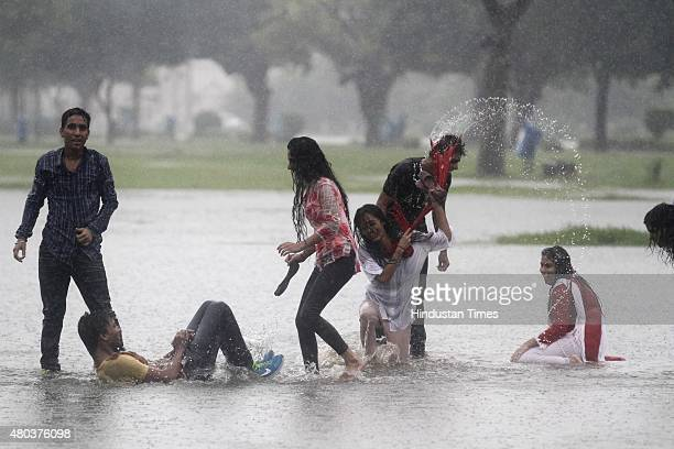 People enjoying at India Gate during heavy rain on July 11 2015 in New Delhi India Heavy rain in Delhi brings the mercury down and causes water...