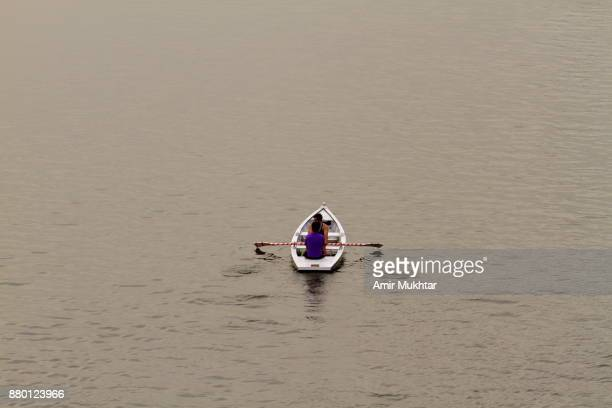 People Enjoying Boating At River Side