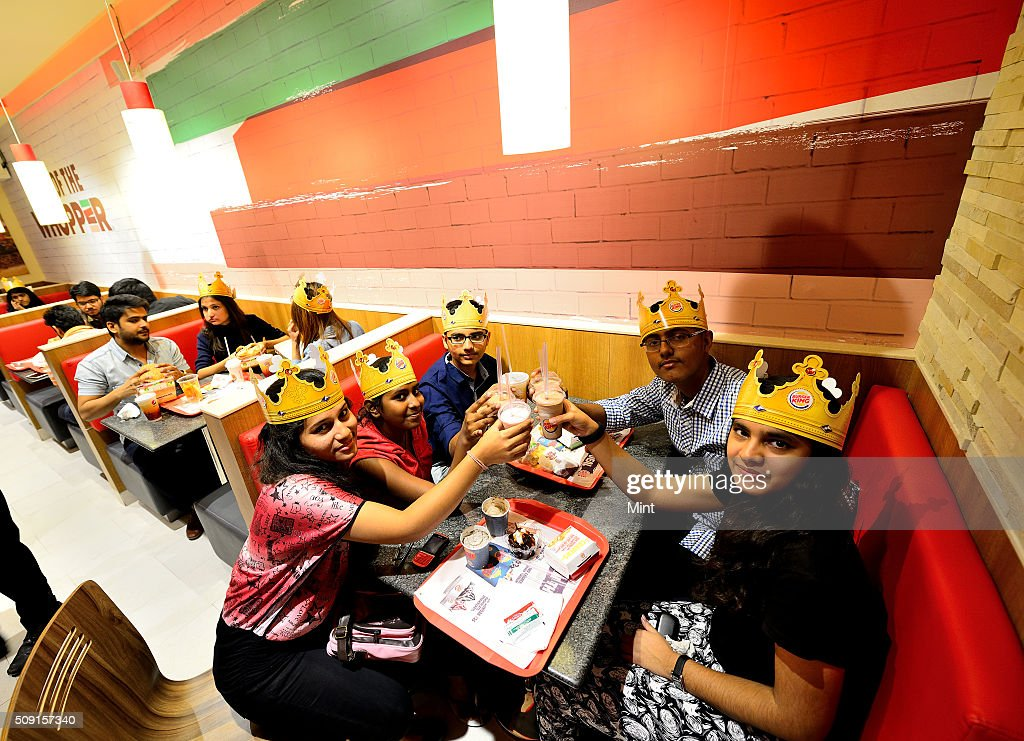 People enjoying burgers of Burger King on November 12, 2014 in New Delhi, India.