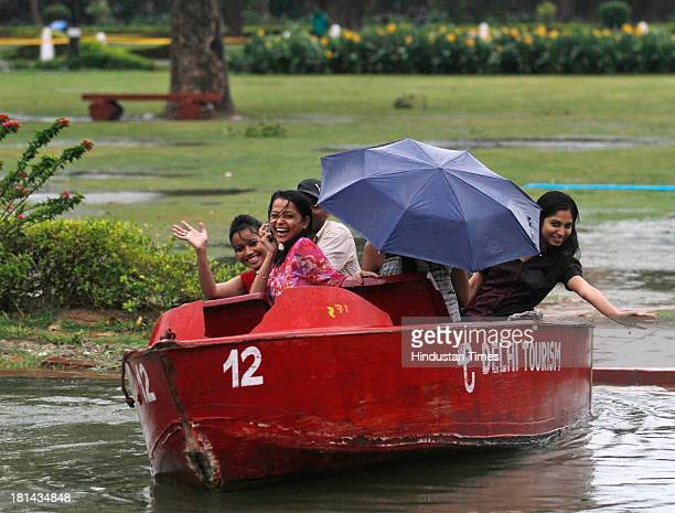 People enjoying during the heavy rain on September 21 2013 in New Delhi India Many parts of Delhi/Noida experienced heavy rains in the afternoon...