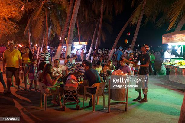 People enjoying evening on beach promenade of El Rodadero Santa Marta Colombia