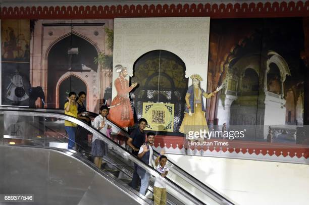 People enjoying first metro ride at ITO to Kashmere Gate section after Union Minister of Urban Development M Venkaiah Naidu and Chief Minister of...