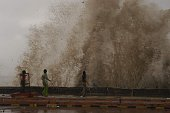 People enjoying giant tidal waves coming off Worli Sea face Mumbai today as mansoon got active in Mumbai and Maharashtra from this week
