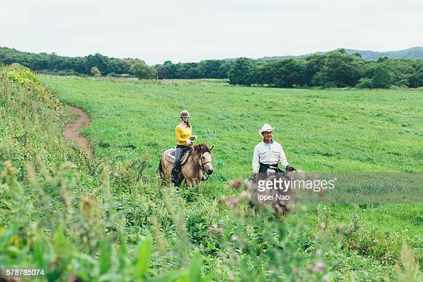 People enjoying horse riding, Hokkaido