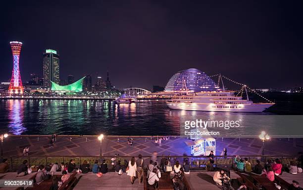 People enjoying magically lit Port of Kobe, Japan