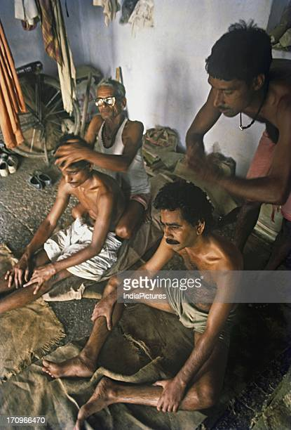 People enjoying massage Benares Uttar Pradesh India