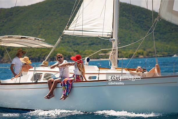 people enjoying sailing on a luxury sloop in the Caribbean