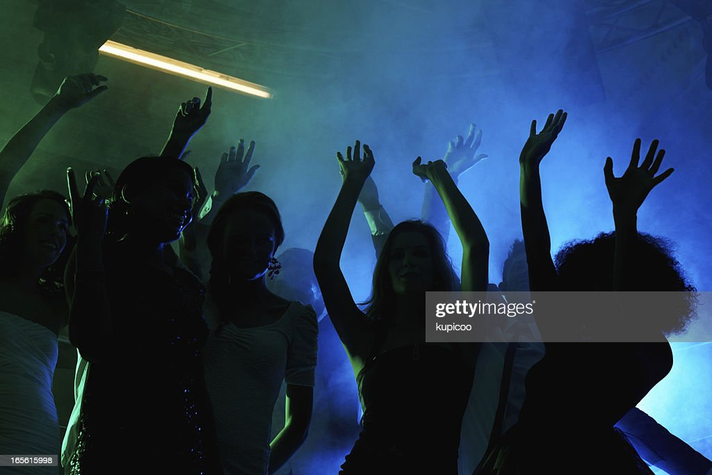 People enjoying the party at a night club : Stock Photo
