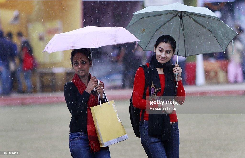 People enjoying the rainfall on February 23, 2013 in New Delhi, India.