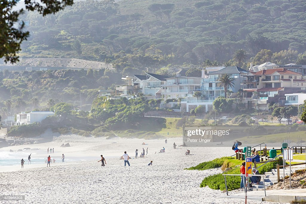 people enjoying the sand at Clifton Beach