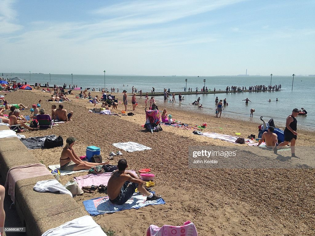 People enjoying the sun on the beach in Southend on Sea in Essex