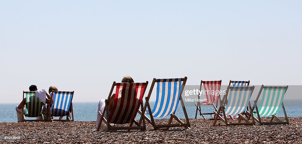 People enjoying the warm weather on Brighton beach on May 7, 2008 in Brighton, England.