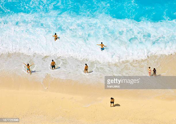 People enjoying the waves at Navagio beach
