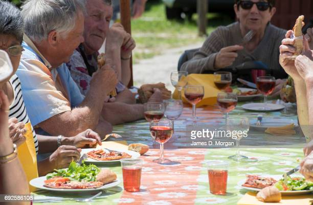 People enjoying their lunch with wine at a local fair on June 5 2017 in Saussignac France Monday is a public holiday in France celebrating 'Lundi de...