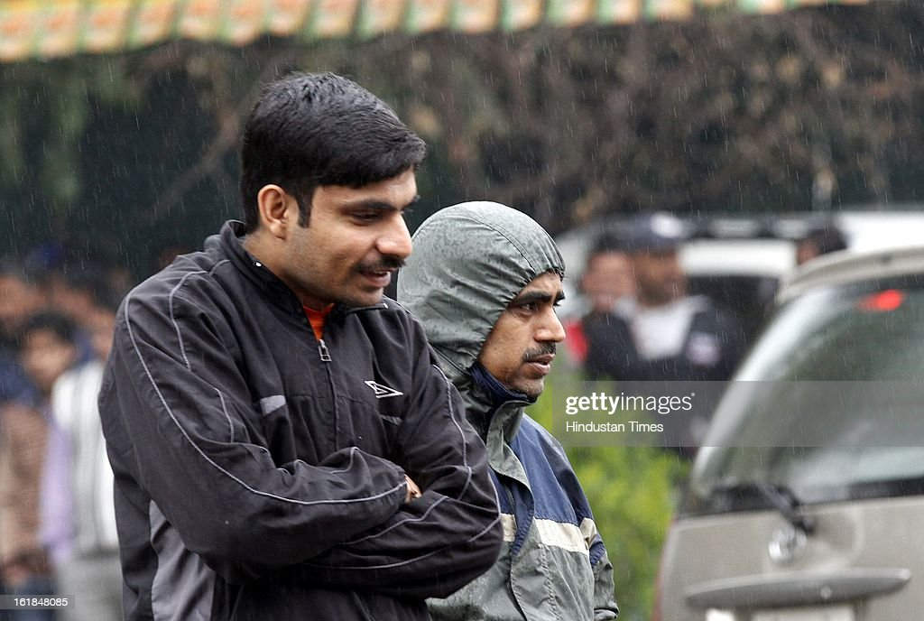 People enjoys during rainy weather on February 17, 2013 in New Delhi, India. The chilly weather in North India continues as rains lash several areas in Delhi, Uttarakhand, Himachal Pradesh and Uttar Pradesh.