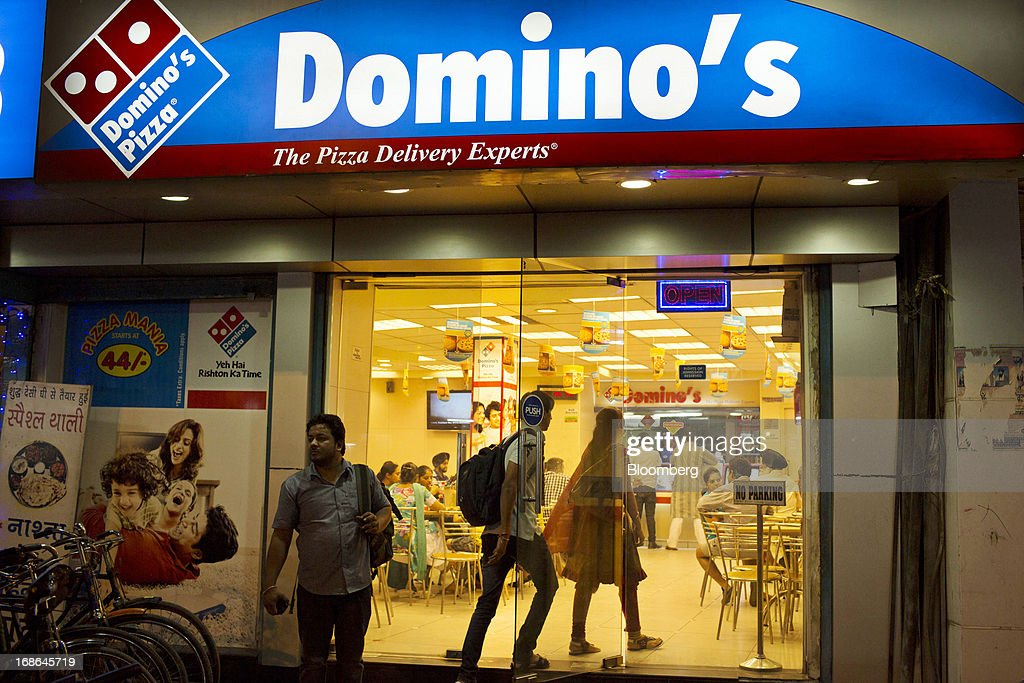 People enter a Domino's Pizza outlet operated by Jubilant Foodworks Ltd. in Amritsar, India, on Thursday, May 9, 2013. India's consumer price index (CPI) for April rose 9.39 percent year on year, the Central Statistics Office said in a statement on its website. Photographer: Brent Lewin/Bloomberg via Getty Images