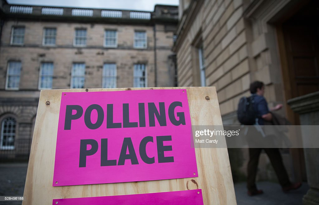 People enter a polling station in central Edinburgh on May 5, 2016 in Edinburgh, Scotland. Today,dubbed 'Super Thursday',sees the British public vote in countrywide elections to choose members for the Scottish Parliament, the Welsh Assembly, the Northern Ireland Assembly, Local Councils, a new London Mayor and Police and Crime Commissioners. There are around 45 million registered voters in the UK and polling stations open from 7am until 10pm.