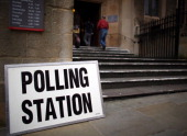 People enter a polling station open for the Bristol mayoral election on November 15 2012 in Bristol England Although attendance is expected to be low...