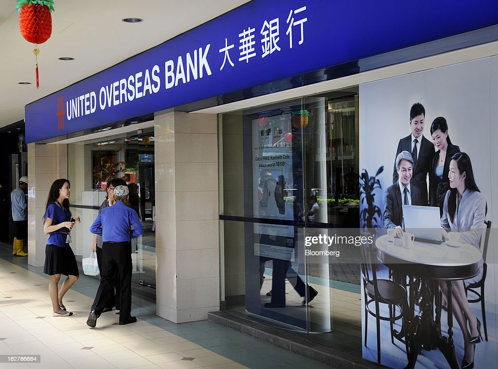 People enter a United Overseas Bank Ltd. (UOB) branch in Singapore, on Wednesday, Feb. 27, 2013. UOB is scheduled to announce full year results today. Photographer: Munshi Ahmed/Bloomberg via Getty Images