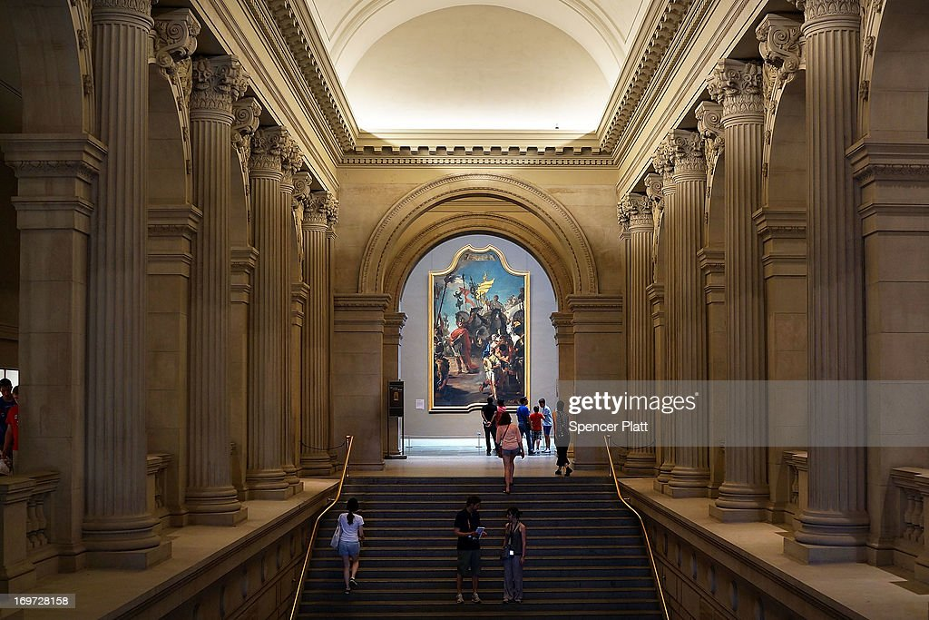 People enter and exit the Metropolitan Museum of Art on May 31 2013 in New York City Many New Yorkers and tourists alike flocked indoors as...