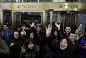 People enter Macy's Herald Square as the store opens its doors at 8 pm Thanksgiving day on November 28 2013 in New York City Black Friday shopping...
