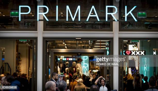 People enter Primark in Amsterdam following its opening on December 1 becoming the biggest shop of Primark in The Netherlands / AFP / ANP / Remko de...