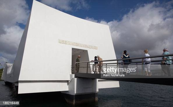 People enter the Arizona Memorial during a memorial service for the 70th anniversary of the attack on the US naval base at Pearl Harbor on the island...