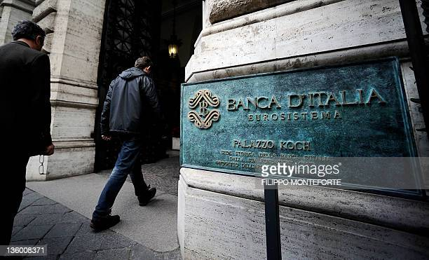 People enter the Bank of Italy in Rome where a conference in honour of the late economist Tommaso PadoaSchioppa takes place on December 16 2011...
