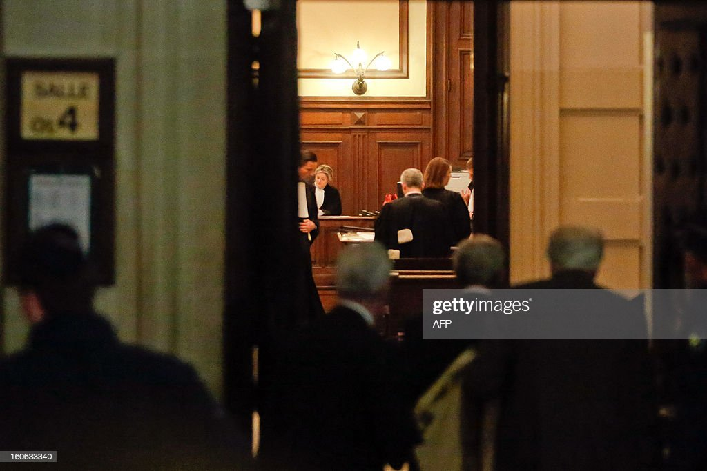 People enter the courtroom in Brussels as Belgium's notorious serial child killer Marc Dutroux appeared before a special court seeking to be released and placed under house arrest with an electronic tag, in February 4, 2013. His appeal for early release comes just threee months before he completes 16 years of his life sentence for the kidnap and rape of six girls, and the murder of four of his victims, in one of the darkest episodes in Belgium's criminal history.