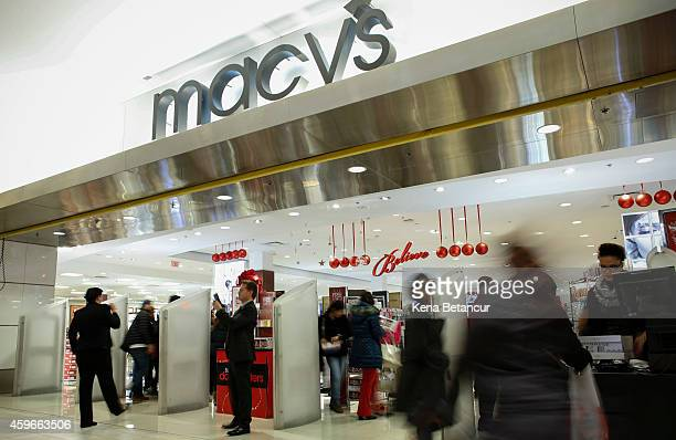 People enter the Macy's store at the Newport Mall on November 27 2014 in Jersey City New Jersey Black Friday sales which now begin on the Thursday of...